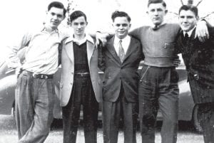 Five Archbold boys in 1942 became men who fought in World War II, except Bud Hitt, at left. Hitt fell from a rooftop, injured his back, and missed the war because of the disability. He was happy to welcome home his four friends, beginning second from left: Richard Walter, Elmer (Shorty) Dominique, Don Porter, Paul Merillat.– Antique photograph from the collection       of Bud Hitt