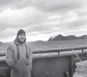 Josh Henry, on the deck of an Alaskan fishing boat in the Bering Sea. While statistically proven to be one of the most dangerous jobs, Henry downplayed the danger, saying as long as the boat's crew and captain communicate, it's no more dangerous than many other jobs. Henry's past jobs include being a musician and bartender.– courtesy photo