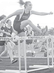 Erin Fricke clears a hurdle.– photo    by D.J. Neuenschwander