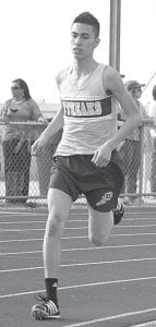 Gabe Rodriguez, shown in action from April 1, finishes third in the 1600 at the Bob Eisenhart Invitational, April 9.– photo by Scott Schultz