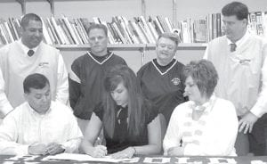 Hailey Galvan, an AHS senior, center, front row, signs a letter of intent to play basketball for Owens Community College, Toledo. Seated with her are her parents, Roel and Dana Galvan. Back row, from left: Mike Llanas, OCC women's head basketball coach; Brian Ziegler, AHS girls head basketball coach; Char Sharp, AHS assistant coach; and Stephen Perry, OCC assistant coach.– photo by David Pugh