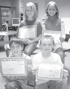 These Archbold Elementary School students, members of Tami Manley's third grade class, were among those who went on a field trip to visit an Amish community in the Camden, Mich., area. The youngsters drew pictures based on their visit. Interviewed were, front row from left: Brendon Johns and Hunter Beaverson. Back row: Marin Parsley and Dakota Stamm.– photo by David Pugh