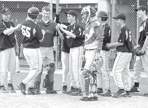 The Blackbirds welcome Kyle Graber (55) home after the junior smacked a home run in Pettisville's 7-5 victory over Stryker, Monday, April 12. Graber and Philip Roth each hit homers in the top of the third inning to pace the Birds.–photo by S cott     Schultz