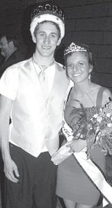 Following a long tradition, the king and queen of the Pettisville prom were crowned during the event, held Saturday, April 17. Zach Waidelich was named the king, while Darci Proudfoot was the queen.– photo by David Pugh