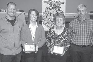 Darin and Sheri Fry, left and Elaine and Curt Eicher, right, were installed as honorary FFA members at the 60th Pettisville FFA banquet. The award is presented annually to community members selected by the FFA membership.– courtesy photo