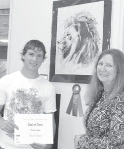"David Lauber, left, with his pen-and-ink drawing, ""King of the Beasts,"" which won the Best of Show award at the Best of Fulton County High School Art Show, April 14-20. With Lauber is Sue Hurst, AHS art teacher. Archbold and Pettisville students receive several awards for their work.–courtesy photo"