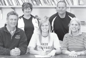 Emily Snyder, an Archbold High School senior, signed a letter of intent to play volleyball at Lake Superior State University, Sault Ste. Marie, Mich. She will major in sports management. With Snyder are her parents, Jim and Sandi. Standing are Julie Nofziger, AHS head volleyball coach, and Dale Grime, assistant coach.– photo by Mary Huber