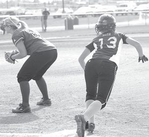 Pettisville's Lauren Roth (13) gets ready to break for second base in the Birds' BBC game with Stryker. Roth hit a single and a triple in the 13-1 victory.–photo by Scott Schultz