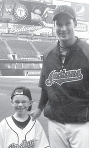 Sam Eberhardt, grandson of Roger and Buzz Ziegler, Archbold, was selected as the honorary batboy for the April 14 Cleveland Indians baseball game. The son of Greg and Krist, Cleveland, he appears with his favorite player, Grady Sizemore.– courtesy photo