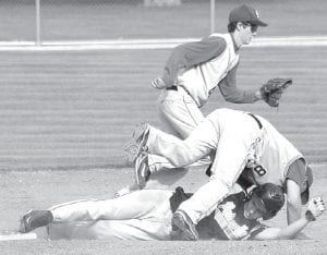 Pettisville's Philip Roth slides and avoids a tag and successfully steals second base in the Birds' BBC contest with Stryker, Thursday, April 29.– photo by Scott Schultz