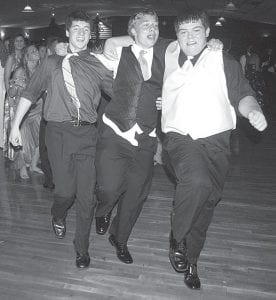 """The Archbold High School 2010 prom was perhaps the most energetic affair in recent memory, as students dressed in their finest dashed, swayed, and jumped about the dance floor. Top, from left: Eliot Nofziger, Drew Lange, and Trevor Neuenschwander kick like chorus line dancers. Bottom: Paige Stamm, Andrea Allan, Abbey Graber, and Devin Newman sport masks that went along with this year's prom theme, """"Welcome to the Masquerade."""" The prom was Saturday, May 8.–photos by David Pugh"""