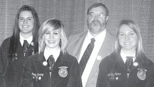 Lynae Fry, Emily Herring, and Ashley Eicher, from left, were awarded the State FFA Degree at the State FFA Convention, Saturday, May 1. With them is John Poulson, Pettisville FFA advisor.– courtesy photo