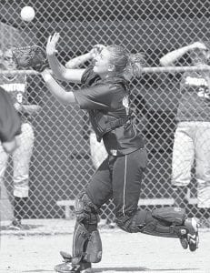 Catcher Morgan Ducey catches the first out of the game. The Streaks easily defeated Swanton, 21-0.– photo by Mary Huber