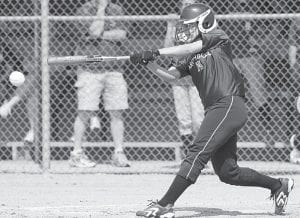 Alyssa Schaub hits a single in the first inning of Archbold's sectional final with Swanton. After stealing second she was brought home by a Sarah Wyse double.–photo by Mary Huber
