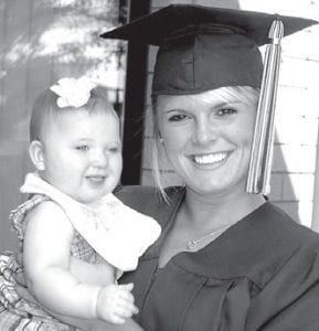 Stacy Wyse, AHS Class of 2010, holds her niece, eight-monthold Zoey Alexis Cordy, after the Archbold High School's 119th graduation ceremony, Sunday, May 30. –photo by David Pugh