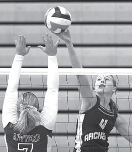 Becca Gerig (4) tips the ball over the outstretched hands of Antwerp's Jessie Arnold in the championship match of the Streak Spike-Tacular, Saturday, Oct. 2. The AHS freshman had 13 kills in the battle for the tournament title with the Archers, which the Streaks won 25-22, 25-27, 25-22.–photo by Mary    Huber