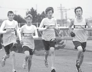 Blue Streaks Bryce Tinsman, Ben Eggers, Nathan Wachtmann, and Zach D'Alelio, from left, keep pace in a tri-meet with Hilltop and Montpelier, Tuesday, Sept. 28.– photo by Scott Schultz