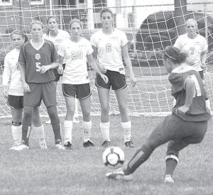 Blue Streaks Lauren Kindinger, Jesse Fidler, Trisha King, Hannah Leininger, and Hanna Allison, in white shirts from left, watch as a Pirate hits a direct kick. Archbold defeated Continental 5-3, Tuesday, Sept. 28.– photo by Scott Schultz