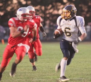 Desmond Sleigh scores the first of his four touchdowns on the night at PHHS.–photo by Mary Huber