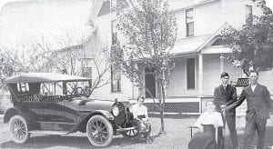 OLD PHOTO CORNER: A Franklin touring car, owned by Jacob Schaffner, Fayette, stands in front of his farmhouse on St. Rt. 66. Sitting on the bumper is Nina Schaffner. At right are Mary, Albert and Jacob Schaffner. – Antique photo     from the collection of Gene Schaffner