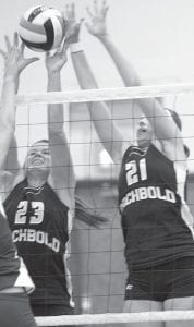 Sarah Wyse (23) and Nicole Hurst (21) partially block the spike of Patrick Henry's Megan Michaelis in their NWOAL match, Tuesday, Oct. 12, at PHHS. The Patriots won the match in three games.–photo by M a ry Huber