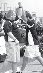 John Horning, PHS head coach, left, high fives Tim Myers, freshman coach, after defeating Edon.–photo by  Mary Huber