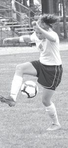 Alicia Drewes shows some fancy footwork in an AHS girls soccer game.– photo by Scott     Schultz