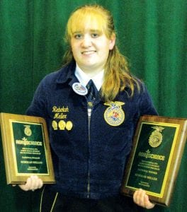 Rebekah Meller holds plaques honoring her as one of eight national finalists for the Agriscience Student of the Year award, and for being named the winner.– courtesy photo