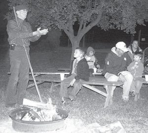 Dale Kern, left, rural Stryker, served as the storyteller for Sauder Village Fall Family Fun Night program, Saturday, Oct. 23. The first fun night was held Oct. 16. Children and their parents participated in activities from riding on the village train, to going through a straw maze, to making caramel apples.– photo by David Pugh