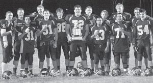 Blue Streak seniors hold the Lions Club trophy after Archbold defeated Wauseon 21-7. The Streaks also assured themselves at least a share of the NWOAL title for the first time since 1990. Front row, from left: Anthony Reyes, Clay Giesige, Ben Miller, Basilio Rosales, Isaac Rosales, Daniel Davis. Back row: Desmond Sleigh, Lucas Hesterman, Drew Leininger, Aaron Bontrager, Andrew Thatcher, Drew Lange, Garrett Morton, Noah Keefer. – photo by Scott Schultz