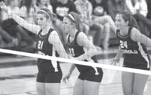 Nicole Hurst, Sarah Wyse, and Jenny Lehman, from left, wait for Taylor Coressel to serve the ball before switching positions in Archbold's sectional semifinal with Swanton. Lehman, a sophomore, led AHS with 13 kills in its sectional final battle with Tinora, while Hurst, a senior, had 12. Wyse, a senior, was 75/77 in setting.– photo by Mary Huber