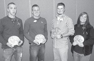 From left, Jeremy Hamilton, Jamison Wyse, Alex Damman, and Linda Chapa, Archbold, have completed the Four County Career Center Adult Education paramedic program. The yearlong program includes 882 hours of classroom and laboratory instruction, plus hospital clinical experience and ride time with area rescue squads. –courtesy photo