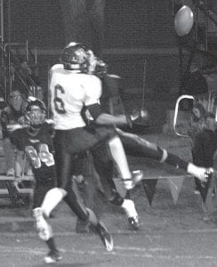 Above: Desmond Sleigh and a Tiger defender leap to catch a pass thrown by Blue Streak quarterback Garrett Morton. Sleigh scored an 85-yard touchdown in the second half to give AHS a 21-0 lead. Left: Danny Young runs for yardage. After Young picked up 15 yards on two carries late in the fourth quarter, Tyson Dietrich went on a 49-yard touchdown run to give AHS a 35-0 lead.– photos by Scott Schultz