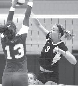 Stephanie Yoder (9), shown spiking the ball in Pettisville's Div. IV district semifinal against Edon, has been named the Buckeye Border Conference Player of the Year in volleyball.– photo     by Mary Huber