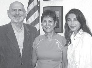 James Arden Ruffer, left with his wife, Margarita, and their daughter, Karen Rae, during an August visit to Archbold and the Buckeye office. During Jim's 40-plus year career in the military, he served in the Marines, Navy, and Air Force. He flew combat missions in Vietnam, and played a key role in the rescue of an American hostage from a Panamanian prison in 1989. His father, an AHS grad, was a military pilot, and his brother was a Marine Corps officer.–photo by David Pugh