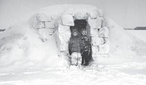 The recent snowfalls that have coated Archbold and the surrounding area have been a source of fun and hard work for youngsters and adults alike. Top: Mya Meck, 7, and Blayn Meck, 6, stand outside the igloo they and their father, Don, built. They are rural Pettisville residents. Far left: Lily Krieger, 10, Archbold, shovels snow in front of her home Wednesday morning, Feb. 2. Left: Andrew Ball, 15, Archbold, snowboards down the pile of snow he and his father Doug shoveled from their driveway on Wednesday.– top photo courtesy Jane Meck; bottom photos by Mary Huber and David Pugh