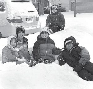 The winter storm that hit Northwest Ohio the night of Tuesday, Feb. 1, resulted in a snow day for schools on Wednesday, Feb. 2. Enjoying their day off while playing in the snow are, front from left: Elizabeth Whiteman, 4; Silas Whiteman, 8; Colin Miller, 8; Noah Garcia, 9; and in back, Logan Miller, 6. They were attempting to build a tunnel through the pile created after the driveway and street were plowed. All are from Archbold.– photo by Mary Huber