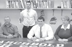 Ben Miller, an Archbold High School senior (seated, center) signed a letter of intent to play football at Lake Erie College, Painesville, a Division II school in the National Collegiate Athletic Association. Sitting with Miller are his parents, Mark and Susan. Standing is Bryan Miller, AHS head football coach.– courtesy photo