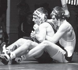 Austin Ripke pinned Delta's Tyler Yant to win the 152-pound championship at the NWOAL wrestling tournament, Saturday, Feb. 12.– photo by Scott Schultz