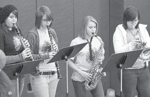 Above: the Archbold pep band entertains the crowd at the Archbold-Wauseon girls basketball game, Thursday, Jan. 27. From left: Morgan Hausch, a junior; Paige Price, a senior; Michaela Zaborniak, an eighth grader; and Kelly Delphous, a sophomore. Below: the Pettisville pep band plays during halftime of the PHS-Stryker girls basketball game, Friday, Jan. 14. From left: Josiah Hoops, Josh Klopfenstein, and Jacob Rupp.– photos by Mary Huber