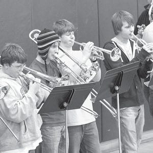 Members of the Archbold pep band perform at the Archbold- Wauseon girls basketball game, Thursday, Jan. 27. They are, from left, Cody Beldon and Riley Krueger, freshmen; Andy Bilen, an 8th grader; Matthew McCoy, a senior.– photo by Mary Huber