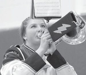 Olivia Krieger, a sophomore trombone player, performs during the Archbold High School Marching Band indoor concert at the AHS gym, Thursday, Nov. 10. The indoor concert marks the end of the marching band season.– photo by David Pugh