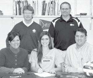 Abby Short, an Archbold High School senior, signs a letter of intent to play volleyball at Goshen (Ind.) College. Sitting with her are her parents, Rachel and Brad. Standing, from left: Jim Routhier, GC volleyball coach, and Dale Grime, AHS co-head volleyball coach.– photo by Mary Huber