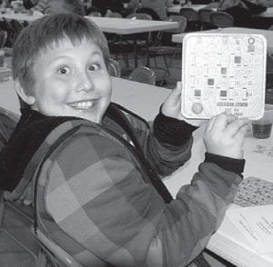 Jacob Smith, 10, Napoleon, won only his second bingo ever, Friday, Nov. 18, at the Ridgeville Feather Party. He was so excited he couldn't catch his breath. The event is sponsored by the Ridgeville American Legion Post 454.– photo by Mary Huber