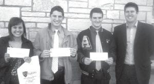 Three Archbold High School students finished second and won a $2,000 scholarship in the Northwest Ohio Junior Achievement challenge, Friday, Nov. 18. From left are Bria Pelmear, Chandler Tuckerman, Zach Driver, and Kirk Weldy, the team's business advisor. All three youths are members of Michele Gladieux's Accounting III class.– courtesy photo