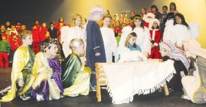 """Archbold Elementary School second grade students told the Christmas story through their musical, """"Melton the Warm- Hearted Snowman,"""" scheduled for last night, Tuesday. Participating in a nativity scene from the play are, from left: Trever Johnson, Triston Rosales, and Ethan Wyse, as three wise men; Karson Rufenacht, as Joseph; Kylee Miller, as Mary; Garrison Cob and Caden Gericke as shepherds. The angels are, from left, Breanna Lloyd, Alicyn Brown, Addison Cervantes, and Anissa Ramirez.– photo by David Pugh"""