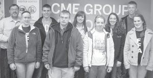 Pettisville FFA members who attended the CME Group opening bell in Chicago, Ill., Friday, Dec. 2, are, front row from left: Annie Eicher, Luke Meller, Brittany Hamilton. Kelsey Weirauch. Back row: John Poulson, advisor; Justin Pursel; Natalie Hubby; Taylor Kruse; Nathan Spotts.– courtesy photo