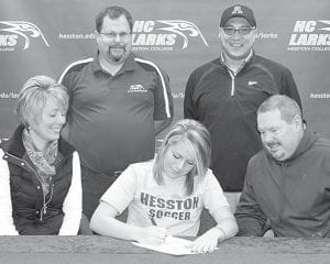 Carley Wyse, an Archbold High School senior, has signed a letter of intent to play soccer at Hesston (Kan.) College. Seated with Wyse, center, are her parents, Julia and Mike. Standing, from left, are Bryan Kehr, HC head women's soccer coach, and James Kidder, AHS head girls soccer coach.– photo by Mary Huber