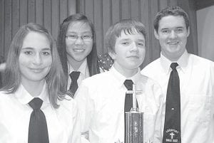 """The team of """"Plotted Against,"""" from Lockport Mennonite Church, was the highest-scoring team at the opening round of Northwest Ohio Bible Quiz action at West Clinton Mennonite Church, Sunday, Jan. 8. All four quizzed correctly in all three of their matches, averaging 163 points. From left: Cara Foor, Hannah Groeneweg, Caleb Short, Tony King.– courtesy photo"""