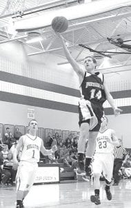 Travis Beck (14) finishes off a fast break with a basket in Pettisville's BBC victory at Hilltop.– photo by Mary Huber